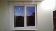 Біле металопластикове вікно з підвіконником